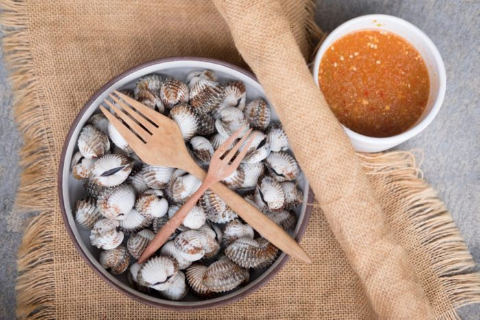 Bowl of clams with dipping sauce