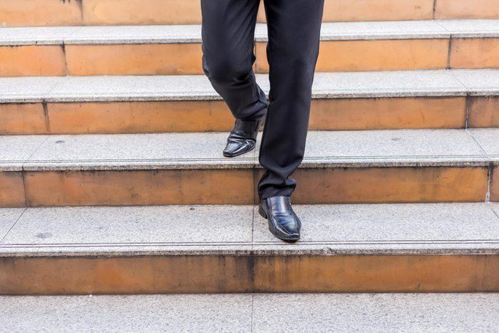 man walking down steps in dress shoes