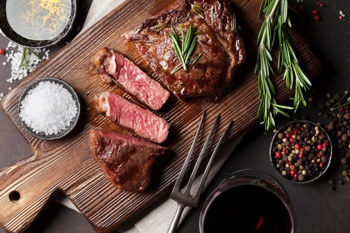 wooden board with red meat