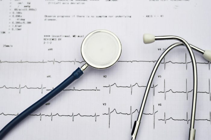 Stethoscope and electrocardiogram (EKG).