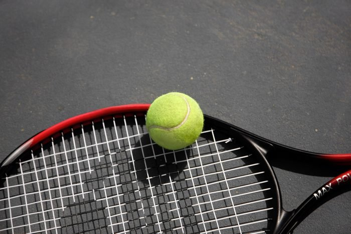 A tennis racket and ball