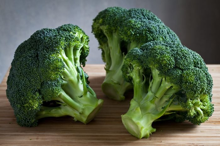 green broccoli on wooden board