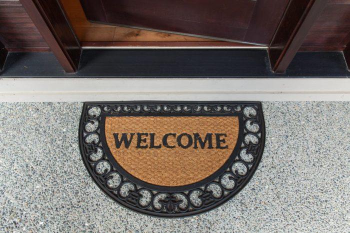Welcome mat with open door