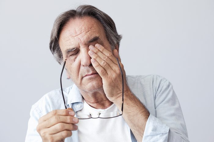 Old man with eye fatigue