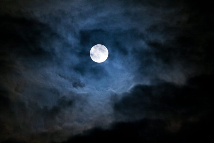 full moon breaking through the clouds
