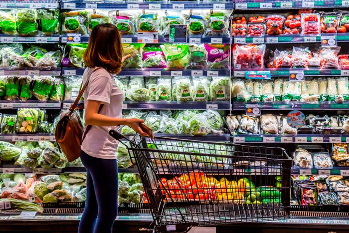 woman with cart in Grocery Store