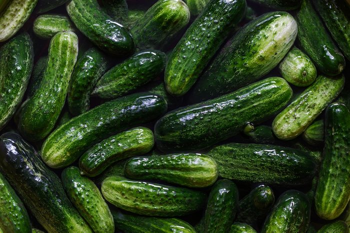 Pile of fresh green cucumbers or pickles