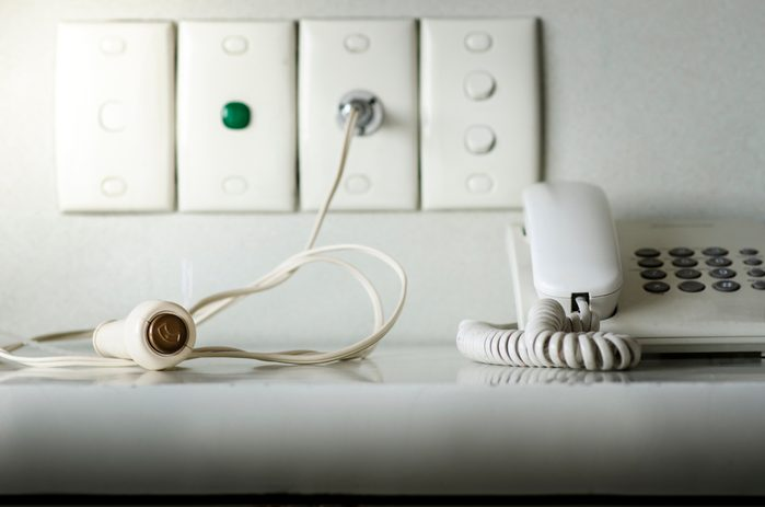 Nurse Call System on wall white background. Call Cord Switch whit Phone on table in hospital. telephone and Call Cord Switch on table in hospital.