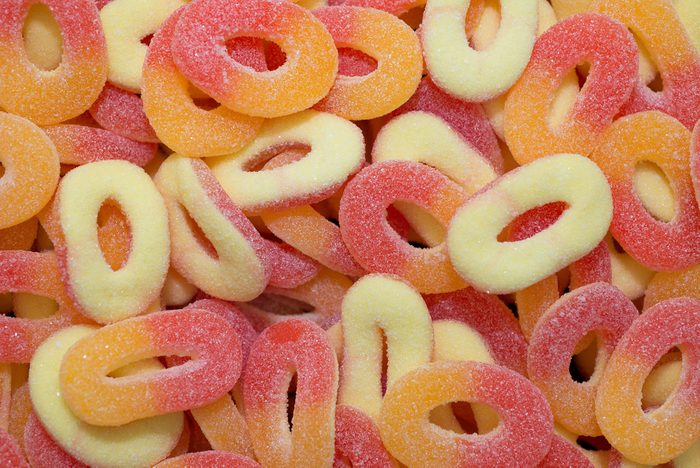 colorful fruit jelly candy in the shape of ring red yellow and peach view from above