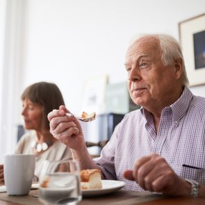 man eating with his family