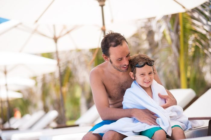 Portrait of man and his son after swimming in the pool