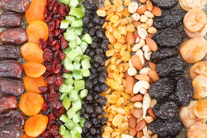 rows of different dried fruit: figs, apricots, cranberries, raisins