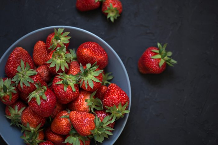 Fresh strawberries in a bowl. bowl with strawberries, freshly picked strawberries concept. Heap of fresh strawberries in ceramic bowl