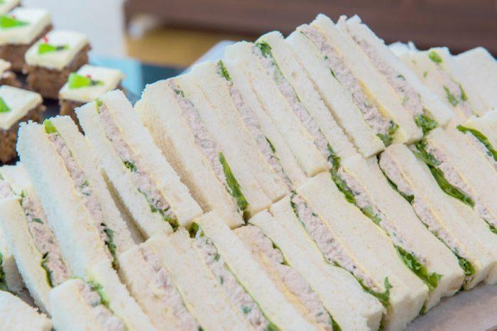 Tuna sandwiches with white bread.