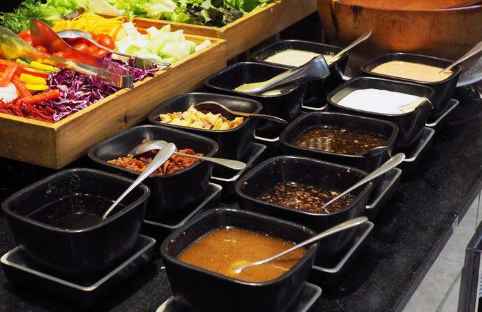 Vegetables for salad bar buffet and salad dressing.