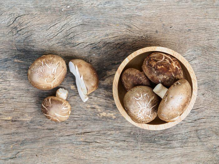 Top view of fresh mushroom (shiitake) on rustic background
