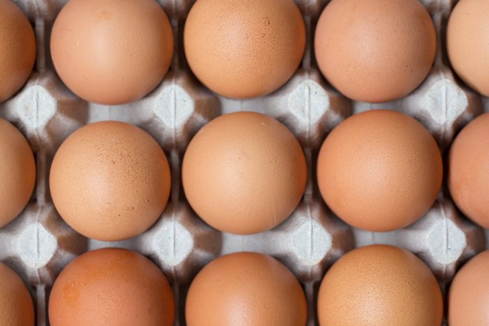 Close up of chicken eggs in package.