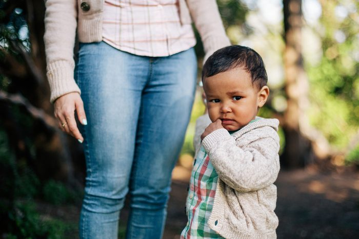 Thoughtful African American Boy holding his mother hand.