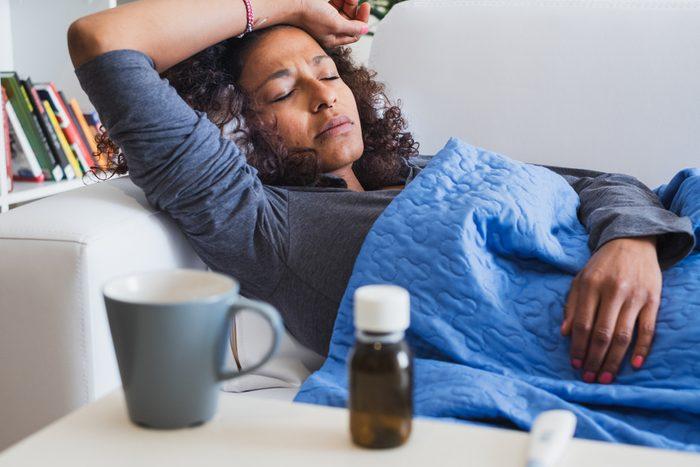 Black woman feeling sick and seasonal flu symptoms