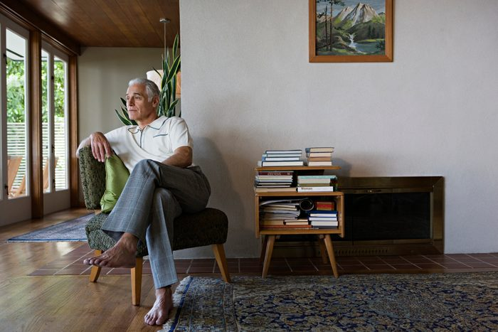 man sitting on chair in house