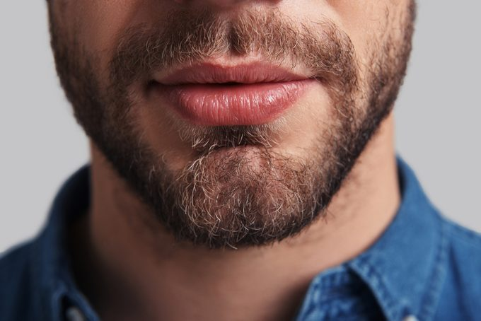 close up of man's mouth and beard