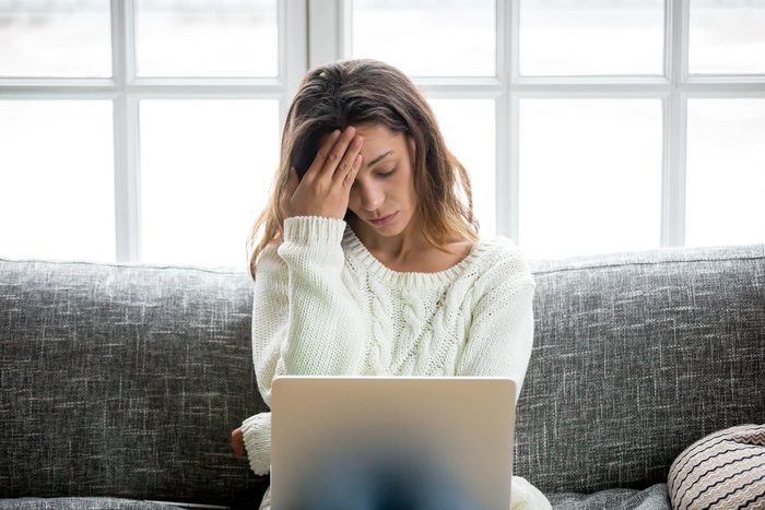 woman stressed looking at her computer