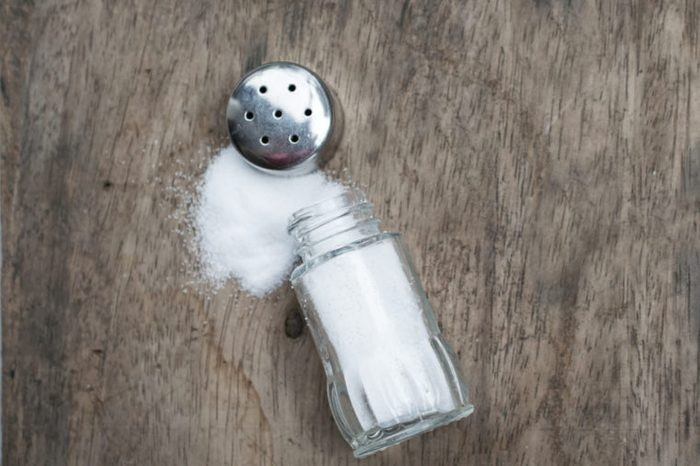 Salt Shaker on the old wooden table