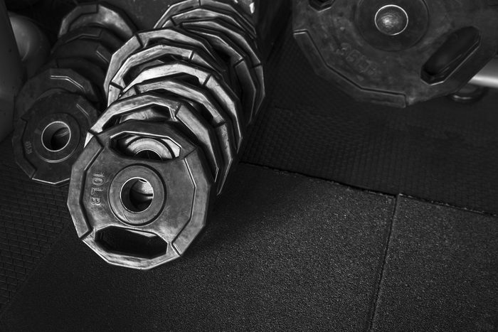 Free weights in the Gym with Dark tone background