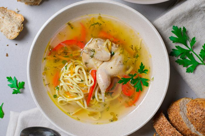 Quail Noodle Soup, Homemade Broth with Noodles and Vegetables Served with Bread Rolls, Comfort Food, Zeama, Traditional Moldavian and Romanian Soup