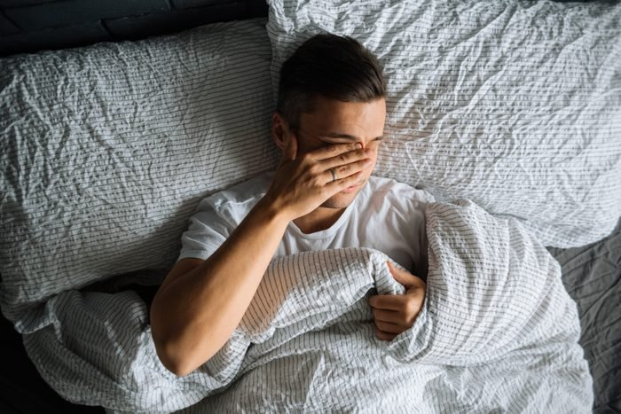 man trying to sleep in bed