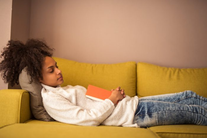 young African American black girl woman nap napping on couch