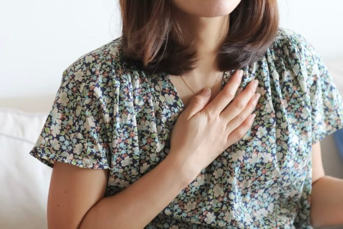 woman hand on heart chest