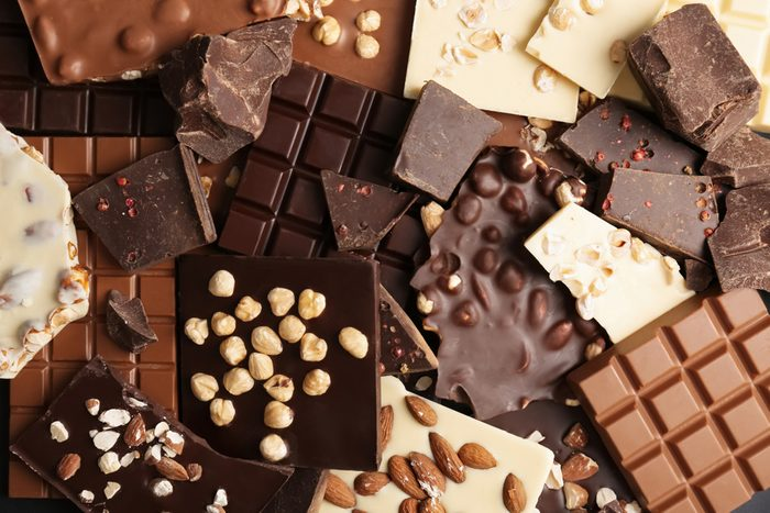 Many different delicious chocolate bars as background
