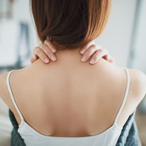 Woman with neck pain, stiff neck
