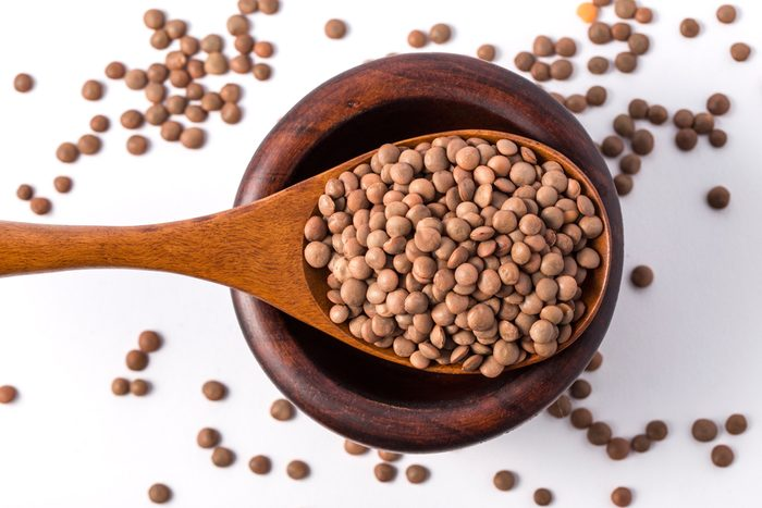 Lentil beans in bowl Isolated on White Background