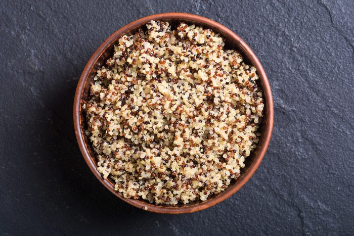 Healthy colorful cooked quinoa . Superfood background