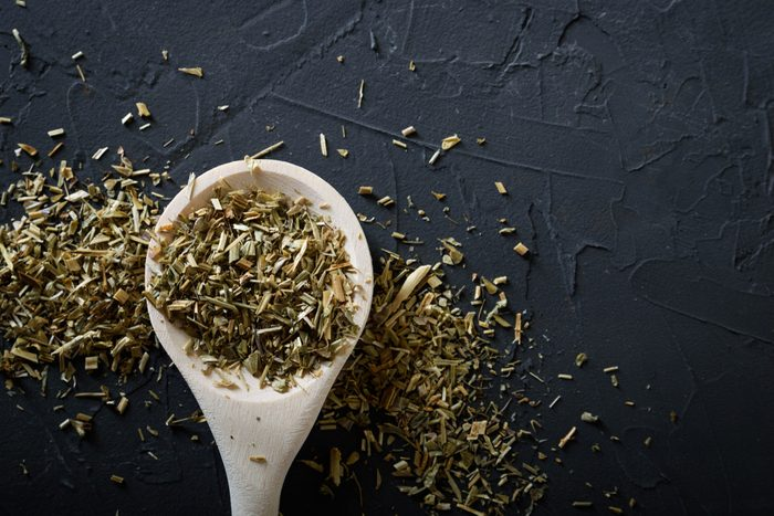 Wooden spoon with Italian seasoning-dried oregano with thyme