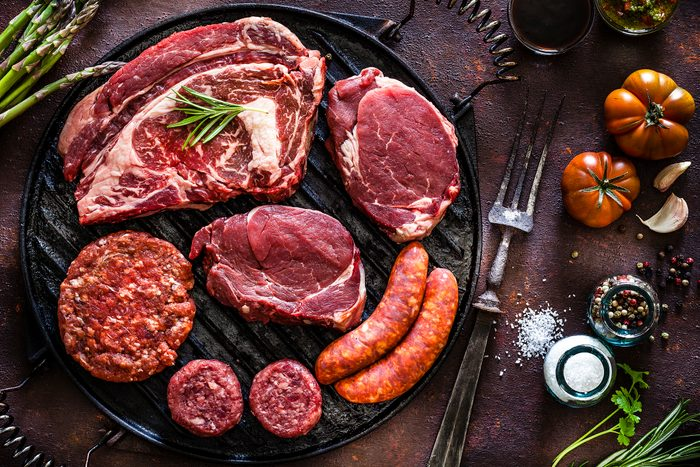 raw steak, burgers and sausages