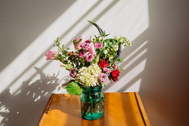 flowers in vase sitting on table