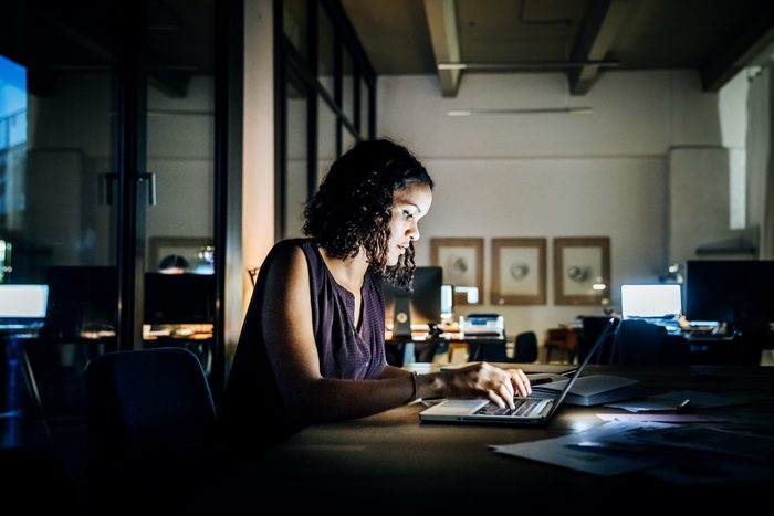 young woman working late