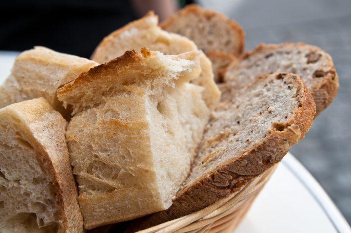 bread in basket - little roll breads in basket on table
