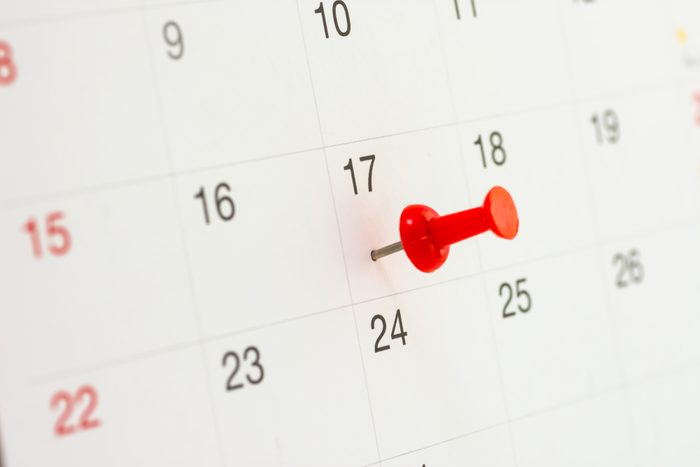 Red push pin on calendar in 17th of month. Red thumbtack a date on calendar or planner. Tax Day 2018 takes place on April 17, 2018