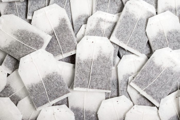 Close-up, a bunch of tea bags lie chaotically.