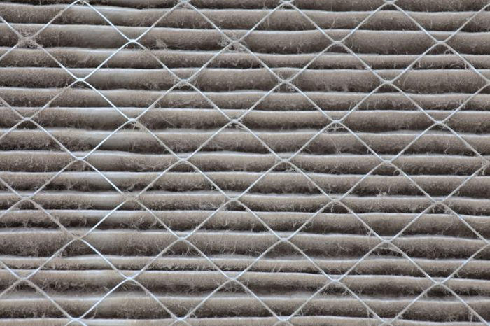 Close up view of a dirty house air filter that needs to be replaced