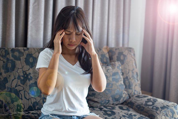 woman headache flare