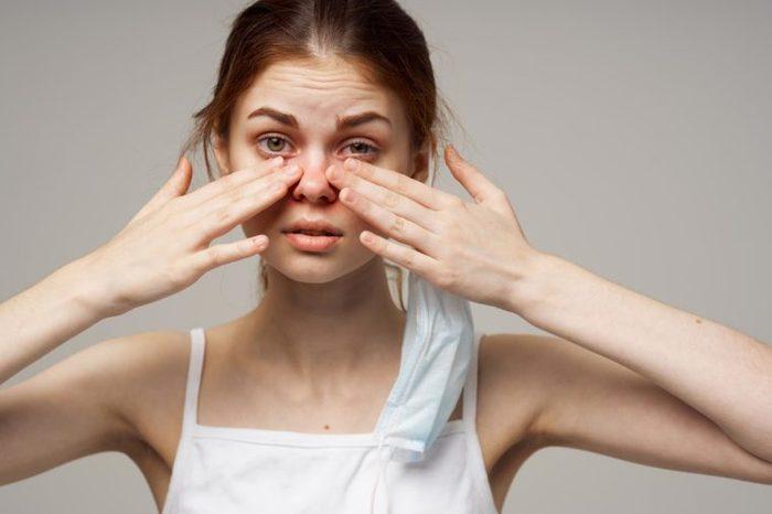 woman rub eye