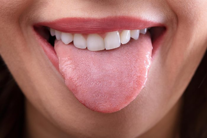 Woman sticking out her tongue.