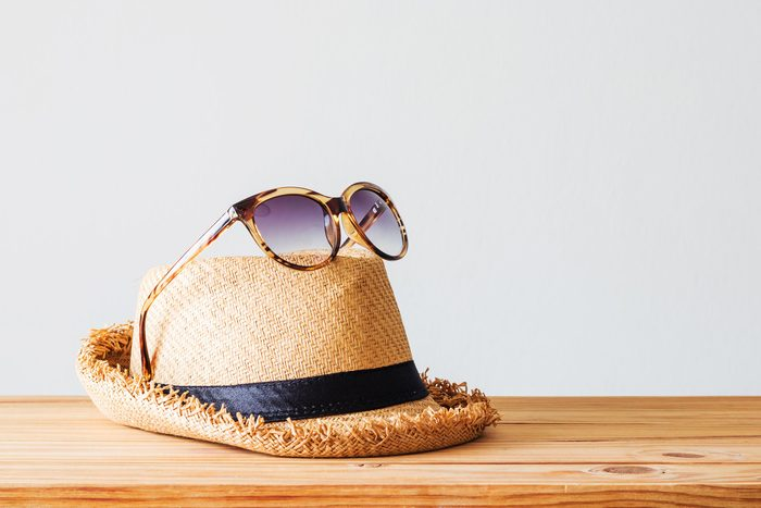 sunglasses on top of sun hat