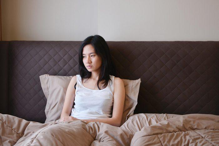 sad woman bed