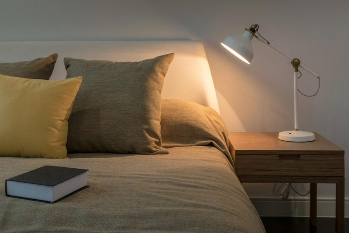 bedside lamp alit next to bed